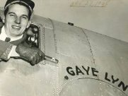 Saunie Gravely, in DC-3 cockpit, points cigar at aircraft  named GAYE LYN, after his daughter.