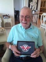 70+ years after co-founding and flying for the airline, Jack Stettner holds the Veterans Air Line logo.