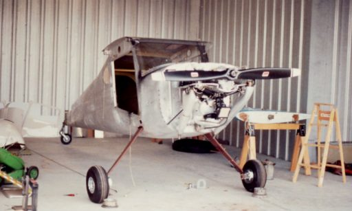 A wingless bird, John Noll's Cessna 120 sits with no wings and no doors in a hangar where John was rebuilding it.