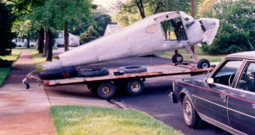 Striped of wings and doors, John Noll's Cessna 120 sits atop a pull trailer for the NJ to FL trip.