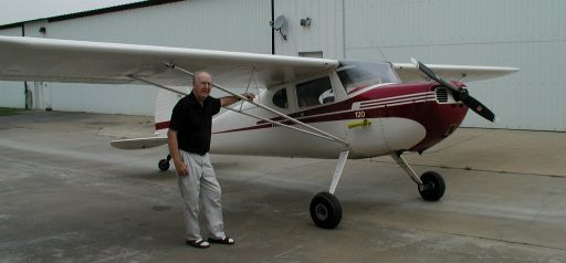 John Noll stands proud and tall next to a beautiful Cessna 120 that he brought back to life!