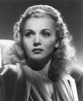 Movie star pose of Carole Landis who re-christened a Veterans Air DC-4.