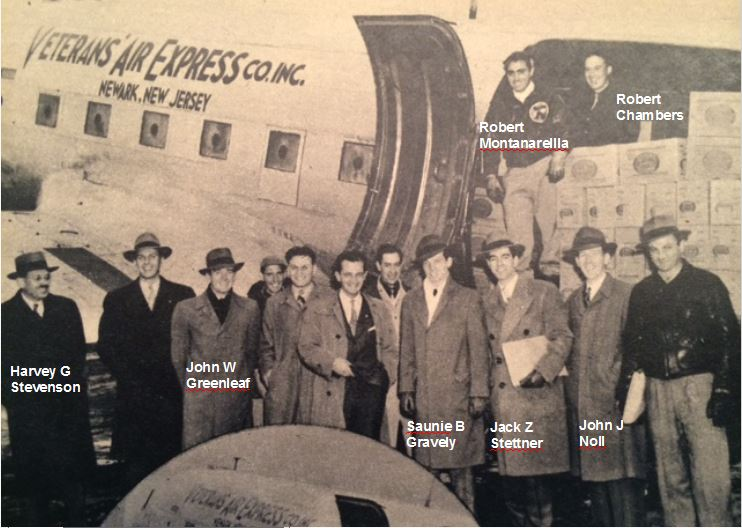 Smiling at the camera are 12 men, many in handsome overcoats and dress hats. Initial founders and crews of Veterans Air Express standing next to their DC-3.