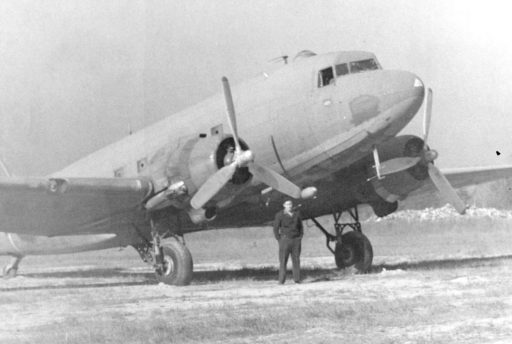 Chief Pilot Robert Chambers in 1945 with the government surplus DC-3 just acquired by Veterans Air Express.