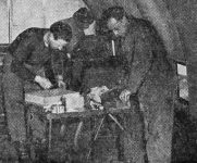 Three VAE buddies converting DC-3 interior. John Noll pilot and William Moroz aircraft mechanic. Center crew member is unidentified.