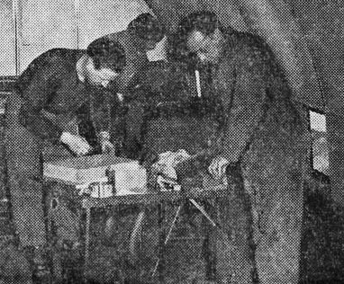 L-to R: VAE pilot John Noll of Bloomfield, unknown pilot, and William Moroz, VAE aircraft mechanic. Working on DC-3 conversion. Photo published: Newark Star Ledger, 2/25/1946