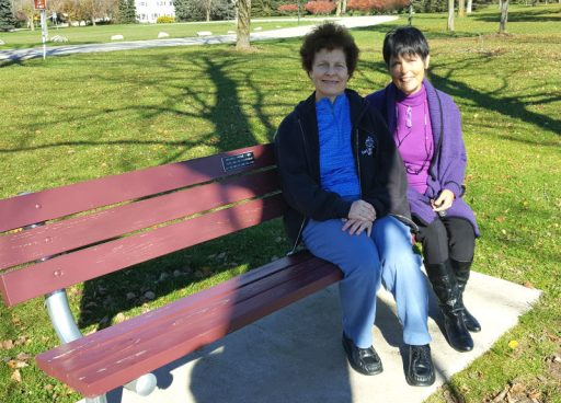 Michele Frome sits with Gaye Lyn on the bench celebrating Michele's father's 90th birthday.