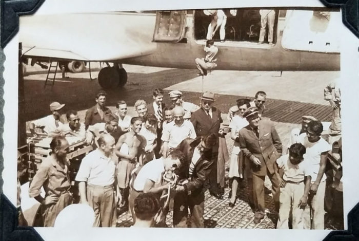 Approximately 20 people gather to welcome the young WWII-relieft dairy calves, gifts from the United States and The Borden Company and coordinated via UNRRA.