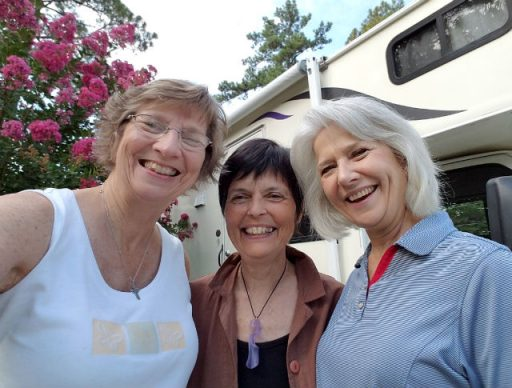 """""""Daughters Cowart"""" Angie and Joy. Gaye Lyn grinning in the middle. Gracie, the RV, behind us."""