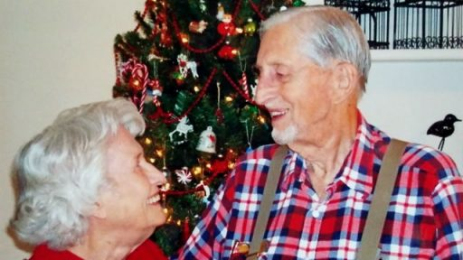 Thomas traded in all uniforms for his trademark overalls, suspenders and plaid shirt. Seen here smiling sweetly at Loney Mae in front of a Christmas tree.