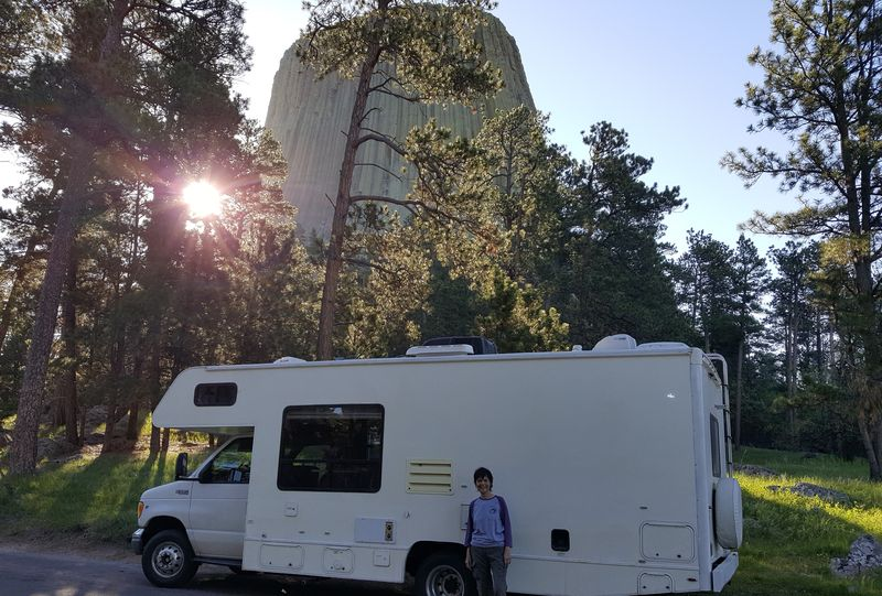 Magnificent Devils Tower National Mounument looms tall behind Gaye Lyn and Gracie - who is still looking like a bakery truck! (Color decals are in her future.)