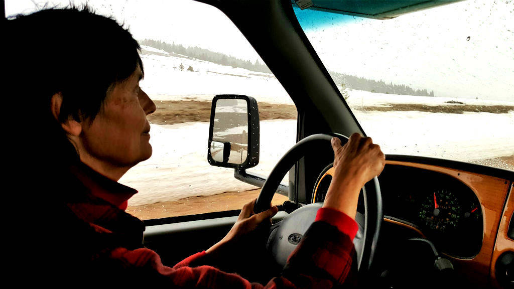 The Veterans Air magic carpet climbs undaunted through a Montana mountain pass. The powerful Ford350 V10 motor makes Gaye Lyn confident on roads she travels. This photo captures the journey before fresh snow began to fall.