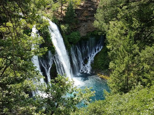 Burney Falls splits into two cascading flows that plunge into a brilliant aquamarine pool 129 feet below.