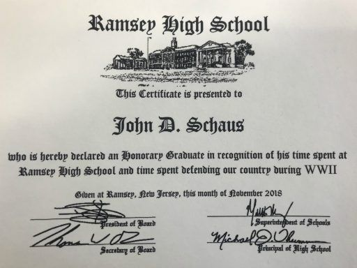 "The Honorary Graduate certificate is in recognition of John D. Schaus' ""time spent at Ramsey High School and time spent defending our country during WWII."""