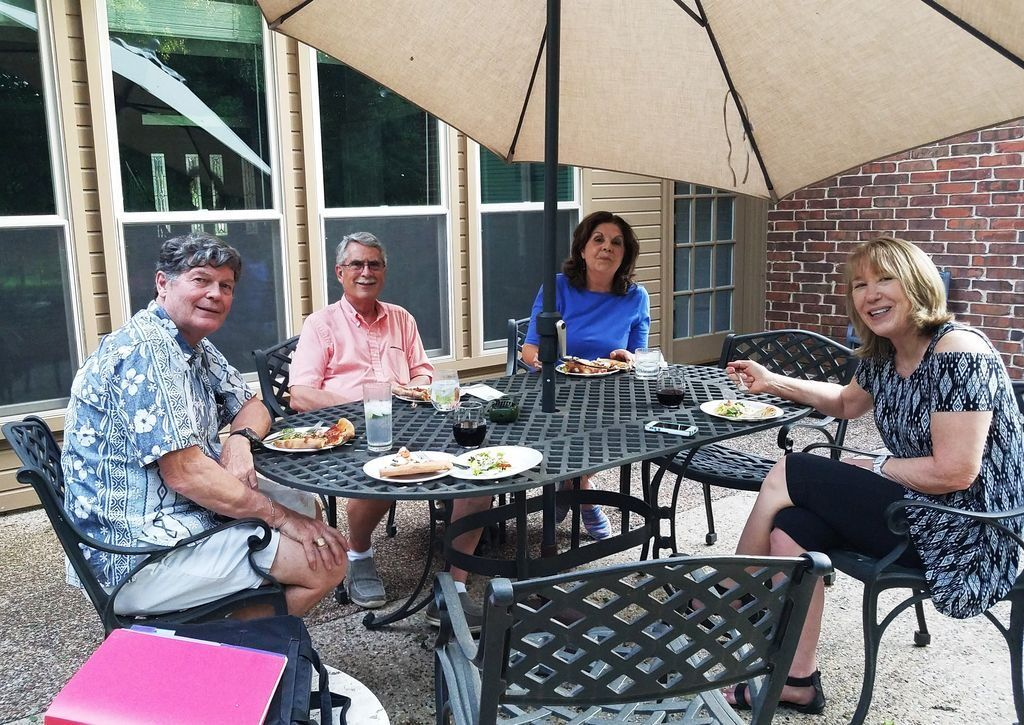 Seated at their patio table at opposite ends, Buffy Noll and Jack Wimmer host Bob and Diana Chambers.