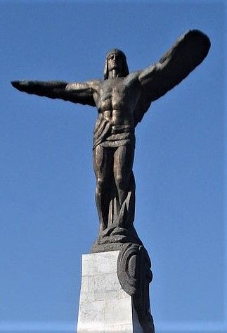 Muscular bronze body with outstretched winged-arms. A closer look at statue atop Monument to Heroes of the Air.