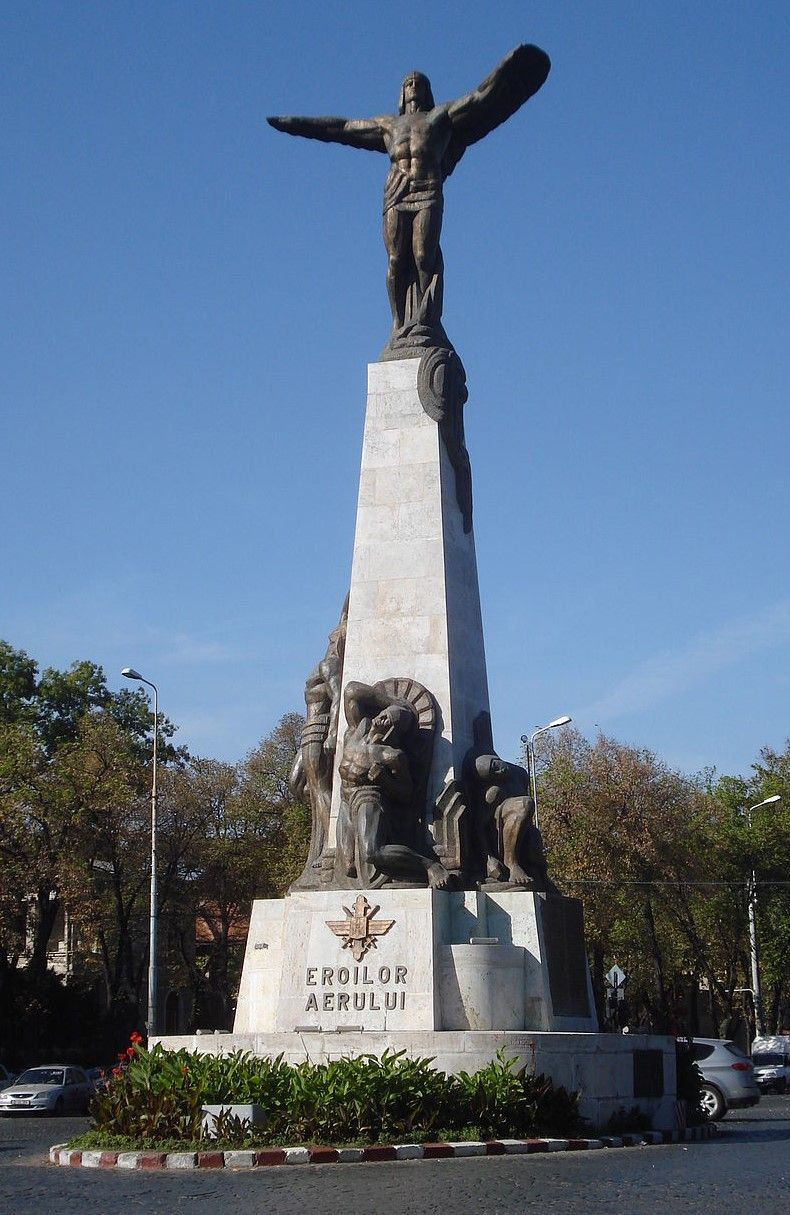 "Monument is stunning bronze sculpture reaching 65'6"" atop a stone pedestal in Bucharest, Romania."