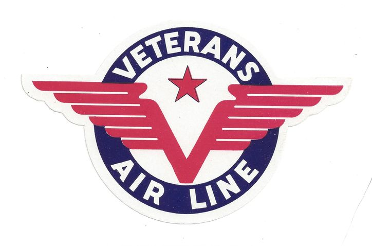 Baggage Label for Veterans Air Line. Striking art deco wings in red extended outside a solid blue circle with company name in white. So pristine it looks right off the printing press.